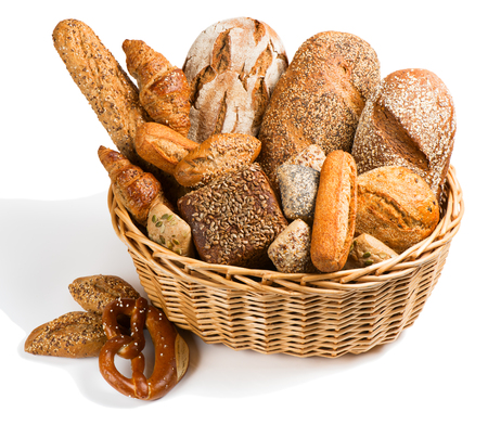 Bread assortment in a basket  isolated on a white background. 版權商用圖片