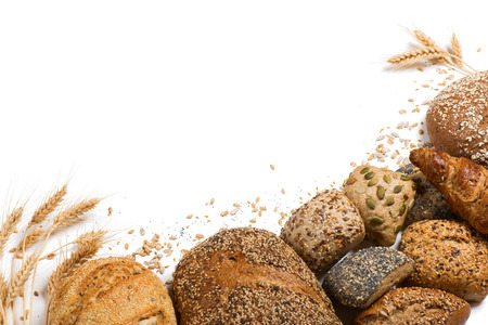 bread: Top view of cereal bread, ears of wheat and different seeds isolated on white background. Stock Photo