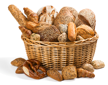 integral: Big wicker basket full of different types of bread isolated on a white background. Stock Photo