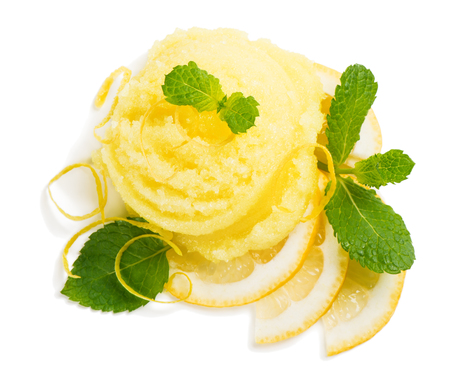 lemon slices: Top view of scoop of lemon ice cream decorated with zest and mint isolated on white background.