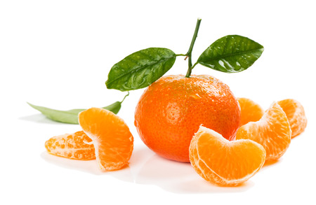 clementine fruit: Tangerine or  clementine fruit with green leaves and slices isolated white background. Stock Photo