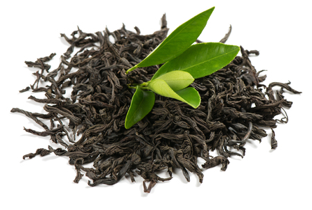 Heap of dry tea with green leaves isolated on a white background.