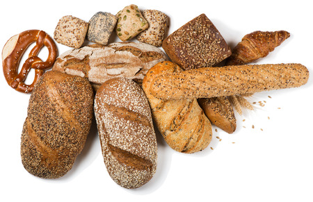 Top view of variety bread and pastry decorated with natural cereals isolated on white background.