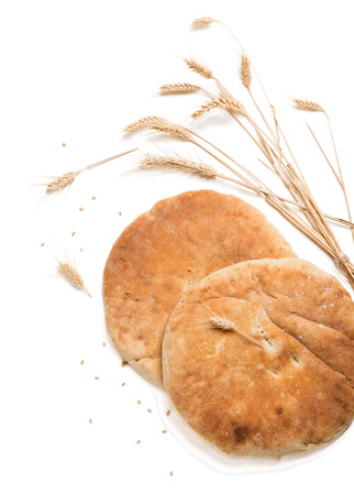 spongy: Top view of two homemade pita bread decorated with ears isolated on white background. Stock Photo