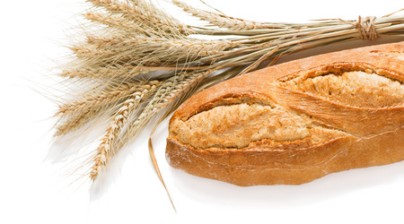 sheaf: Loaf of baguettes bread and sheaf of wheat isolated on white background.