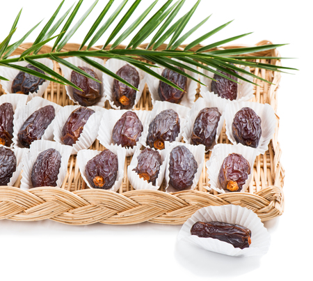 palm fruits: Dried date palm fruits with green leaf isolated on white background.