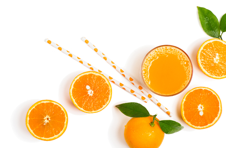 freshly: Top view of freshly squeezed orange juice with orange fruits with green leaves with drops of water isolated on white background.