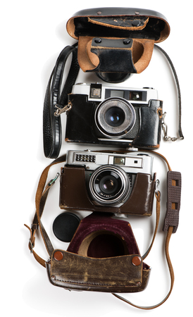Isolated used  two vintage film photo-cameras with leather cases. Above view.