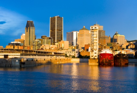 Reflection of the sun at daybreak, on part of the port and city of Montreal