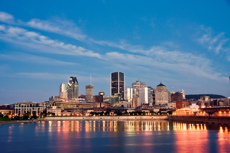 View of Old Montreal with a portion of the port, and office buildings in background at dusk Stock Photo