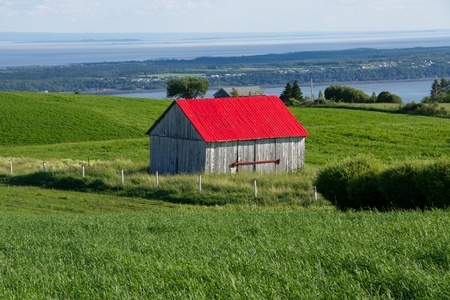 Small barn with red roof in Charlevoix Quebec, Canada