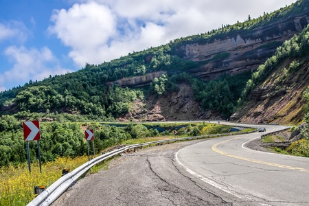 A Car that goes down a Mountain Road Stock Photo