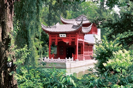HDR Image A Chinese Temple between trees and leafs  photo
