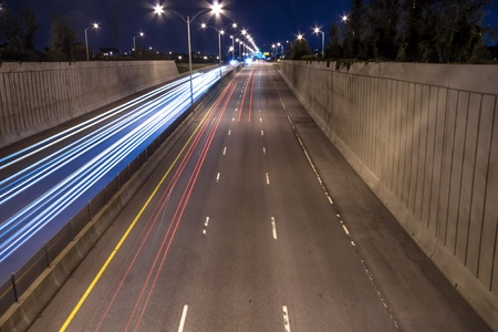 trafic: Speed Cars on the Highway at night scene Stock Photo