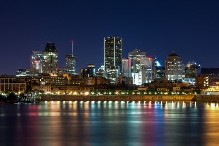 tallness: Downtown Montreal with the light reflection in the water