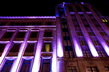 heaving: Building Windows illuminated in purple color in Montreal