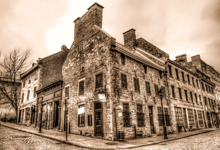 Old Style buildings in Old Montreal, in sepia color with strange clouds in sky HDR image Stock Photo - 16870519