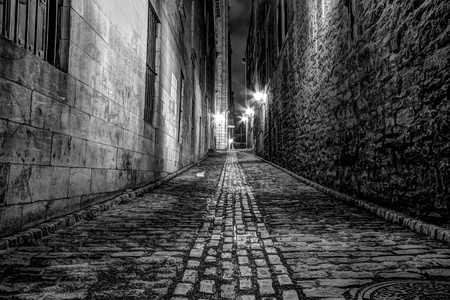 Very Narrow alley in Old Montreal at night in Black and White picture photo
