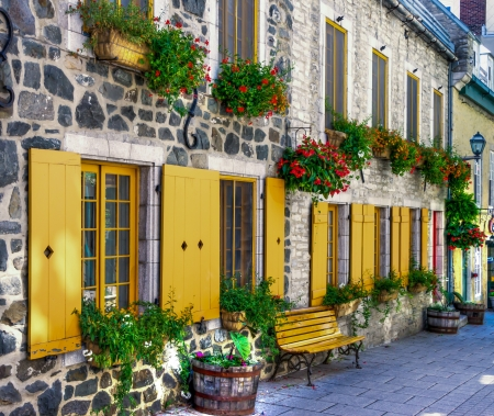 Street in a staging area with bench, flowerpot, typical of Old Quebec city. (HDR image) Stock Photo