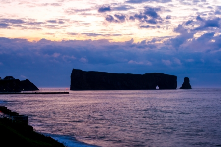 Silhouette of Perce Rock in Gaspe at dusk.