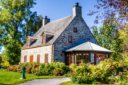 HDR image, One beautiful old Country House with veranda and trees on the land, Quebec