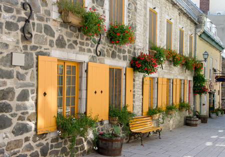 staging: Street in a Staging Area with Bench, Flowerpot, typical of Old Quebec city  Stock Photo