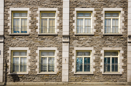 inexperienced: Windows and brick wall in old Montreal