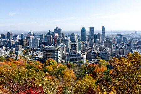 Skyline of Montreal seen from Mont Royal mountain of, with urban skyscrapers in fall season.