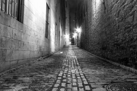 Very Narrow alley in Old Montreal at night in B  W picture