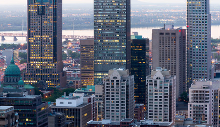 Montreal office buildings, and the church to the left of the picture with a little digital noise at dusk