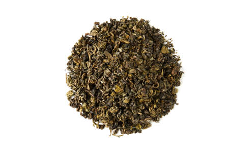 A pile of dry green tea. Isolated on white background. Stock Photo