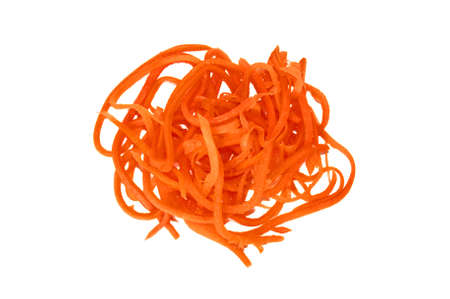 A pile of grated carrots on a white background Banque d'images