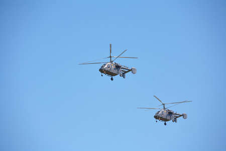 Military helicopters against the blue sky. Helicopter in flight Editorial