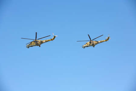 Military helicopters against the blue sky. Helicopter in flight 스톡 콘텐츠
