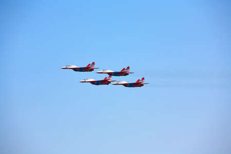 Four military aircraft in a blue sky at high altitude. 報道画像