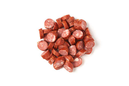 Pile of sliced smoked sausage isolated on white background