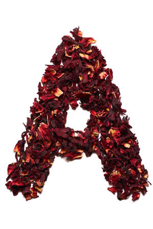 English alphabet. Letter A from dried flowers of hibiscus tea on a white background. Letters for banners, advertisements, menus.