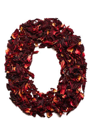 English alphabet. Letter O from dried flowers of hibiscus tea on a white background. Letters for banners, advertisements, menus. Stock Photo