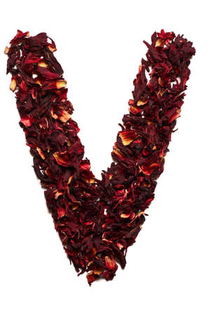 English alphabet. Letter V from dried flowers of hibiscus tea on a white background. Letters for banners, advertisements, menus.