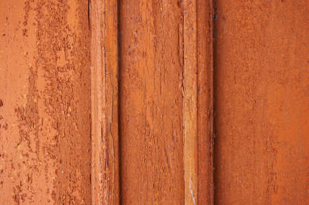 Old wooden background colored paint with cracks, scratches and abrasions. Banque d'images