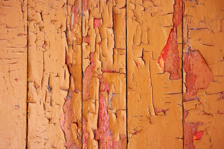 Old wooden background colored paint with cracks, scratches and abrasions. Stock Photo