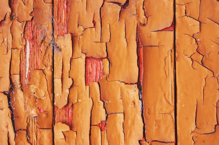 Old wooden background colored paint with cracks, scratches and abrasions. Imagens