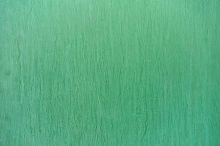 Green background with spills and ink stains. Abstract background.