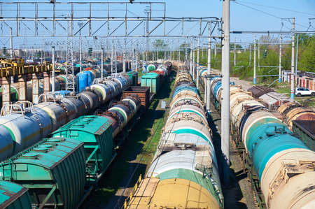Railway landscape with many old railway freight cars on rails on a sunny day close up.