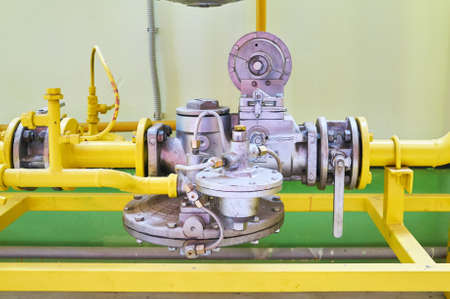 Gas pressure regulator in the conduit colored yellow.