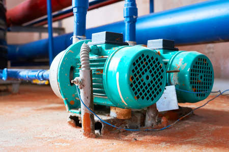 Blue engine with a pump connected to the pipes blue. Reklamní fotografie