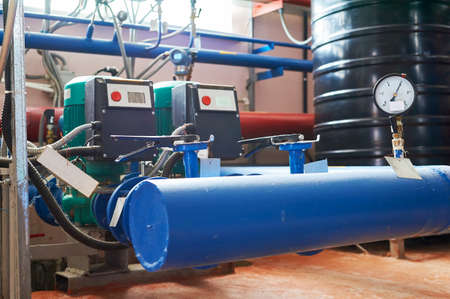 Blue pump motor and the inverter connected to the pipes blue.
