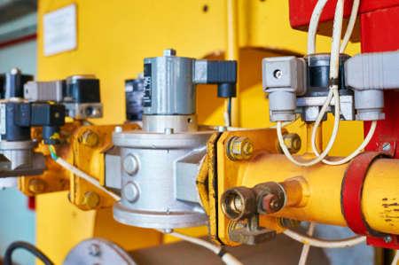 Gas pressure regulator in the conduit colored yellow.