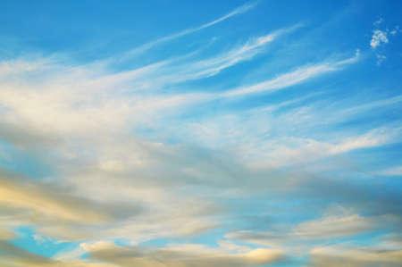 Wavy, curly, porous clouds against a blue sky. Nature Background