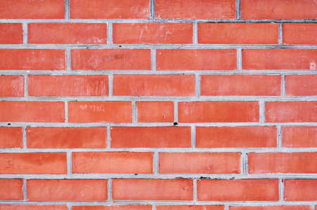 Empty red brick wall textured background. Stock Photo